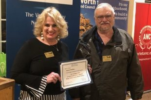 NWNC President Paula Bolin & Treasurer Glenn Wilson Accept Award